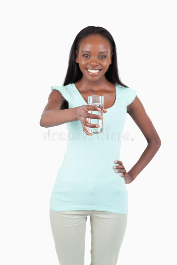 Download Smiling Young Water Offering A Glass Of Water Stock Image - Image of refreshmant, pretty: 22046993