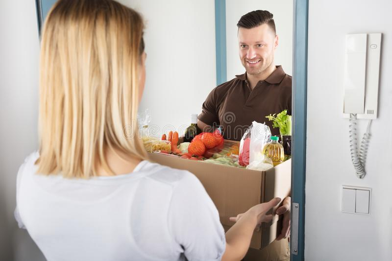 Delivery Man Holding Groceries royalty free stock photography