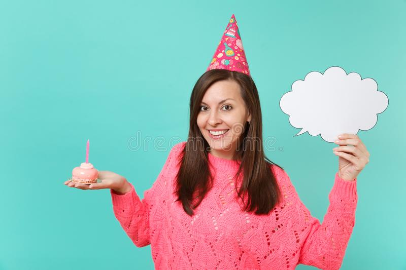 Smiling young woman in birthday hat hold in hand cake with candle empty blank Say cloud speech bubble for promotional. Content isolated on blue background stock images