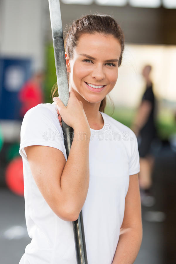 Smiling young woman at crossfit center stock photos