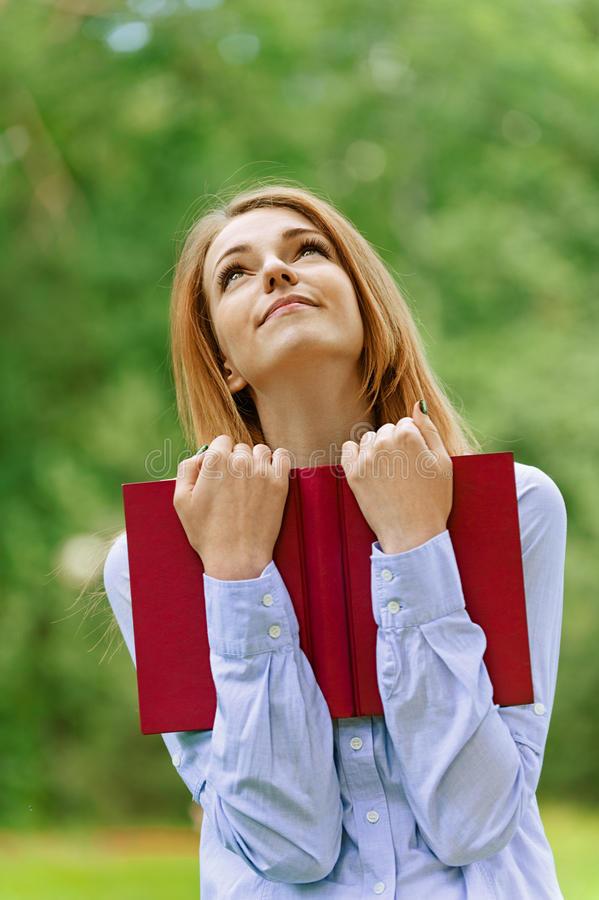 Download Smiling Young Woman In Dark Blouse Stock Photo - Image: 26592062