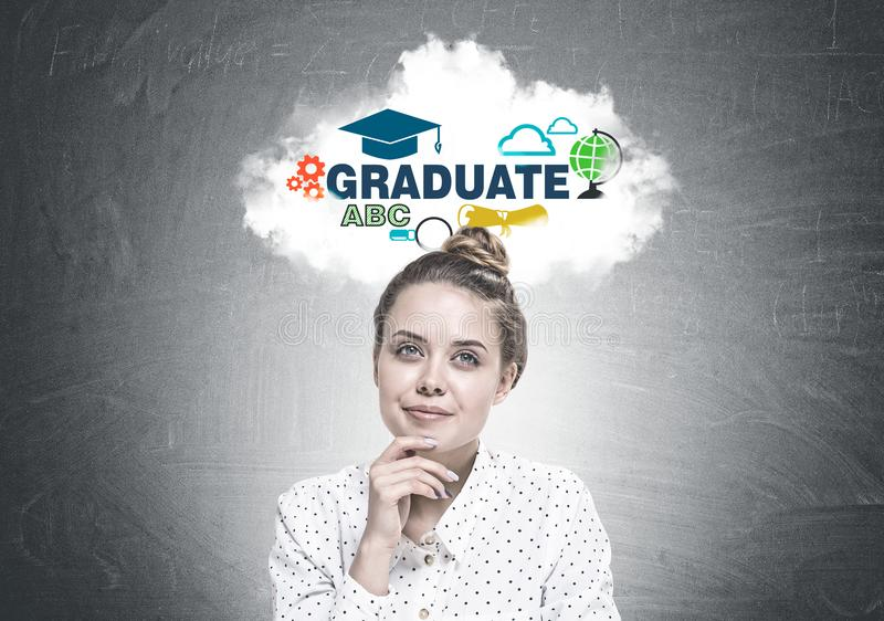 Smiling young woman dreaming, graduation stock photography