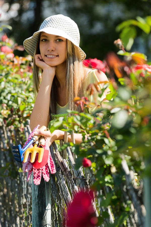 Smiling young woman florists in apron working stock photography