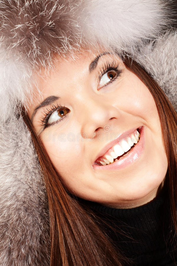 Smiling Young Woman In Fur Hat Royalty Free Stock Photography