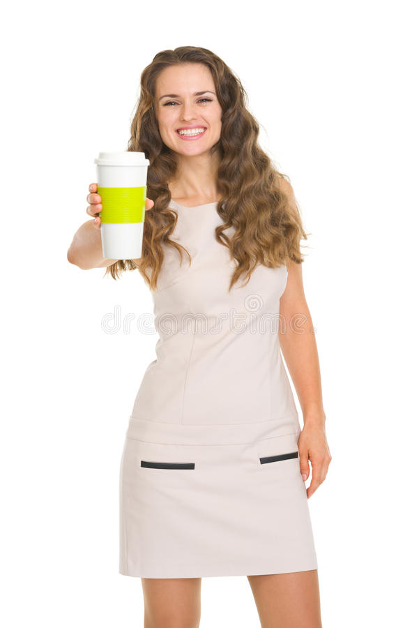 Smiling young woman giving coffee cup