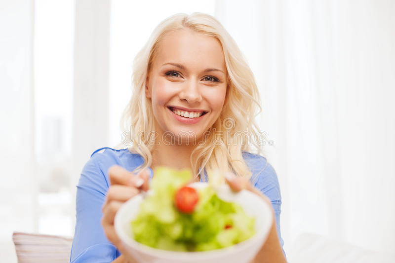 Download Smiling Young Woman With Green Salad At Home Stock Photo - Image: 40042469