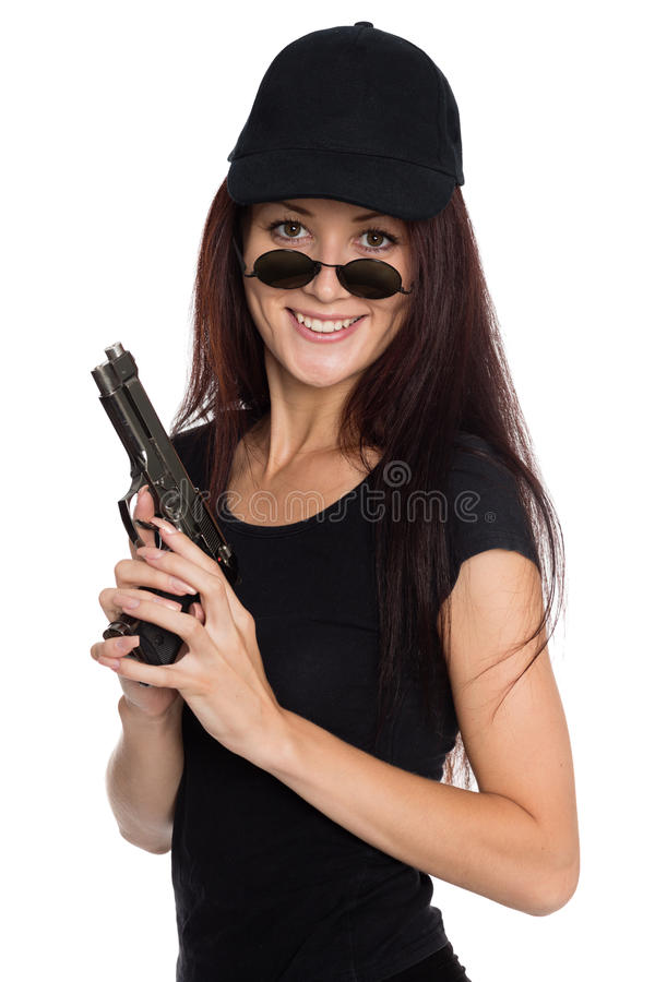 Smiling young woman with a gun stock photo
