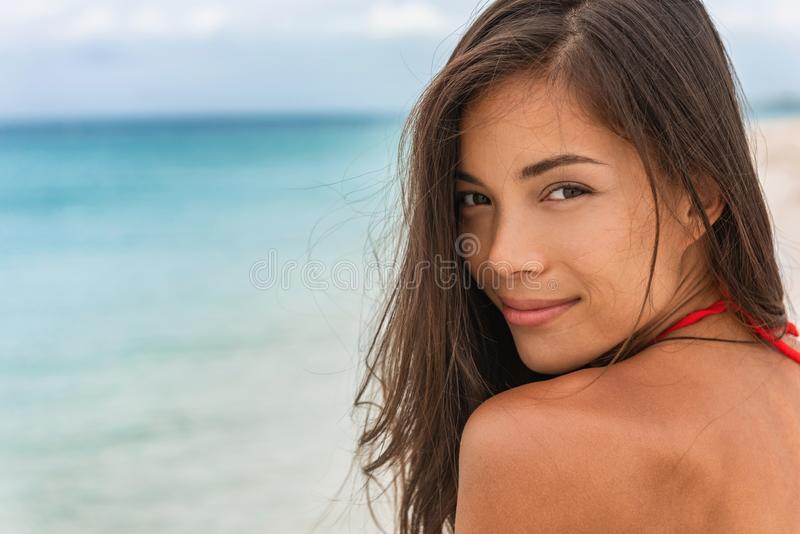 Smiling young woman happy relaxing on beach holidays. Beauty model portrait healthy lifestyle young chinese caucasian girl in her. 20s royalty free stock photography