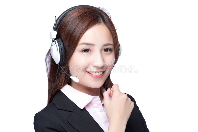 Smiling young woman with headphone. Smiling business woman show fist with headphone isolated white background, asian royalty free stock image