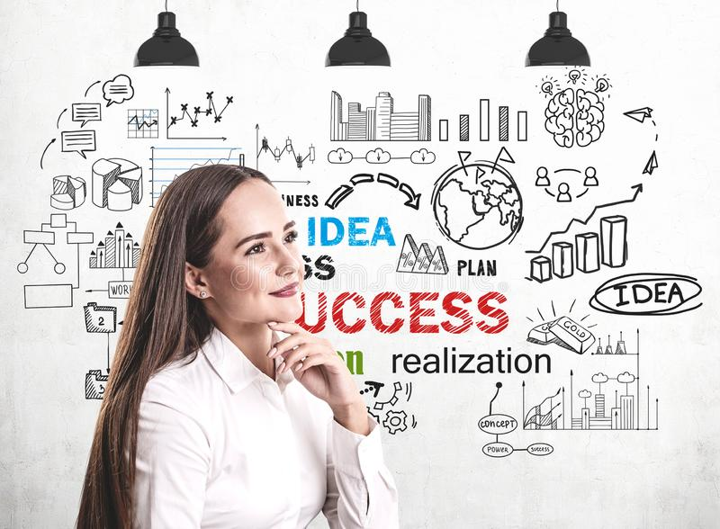 Smiling young woman and her business success stock photo