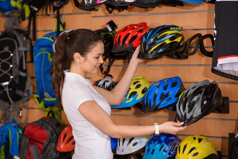 smiling young woman holding bicycle helmets stock photos