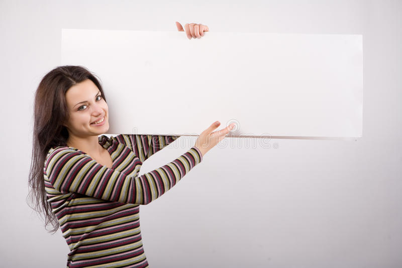 Download Smiling Young Woman Holding Blank White Billboard Stock Photo - Image: 11151016