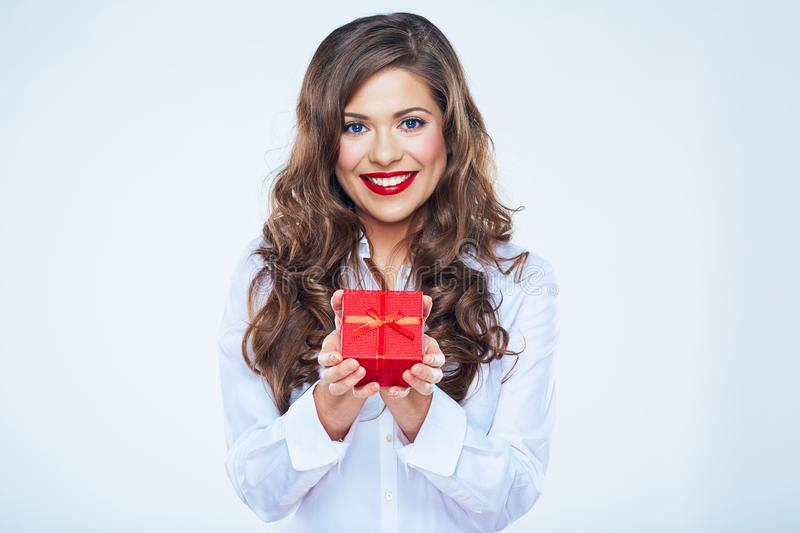 Smiling young woman holding red gift box stock photography