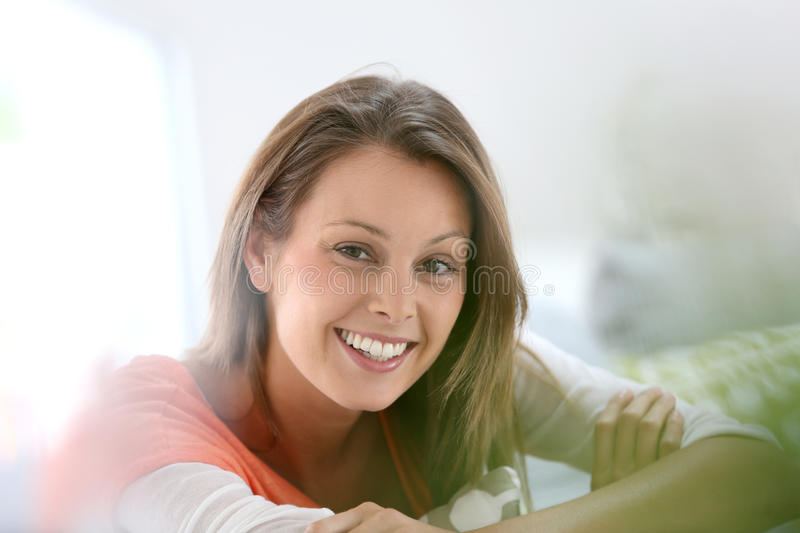 Smiling young woman at home. Portrait of attractive young woman stock photos