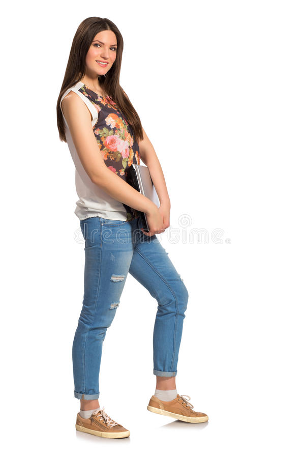 Smiling young woman, with laptop full height royalty free stock photography