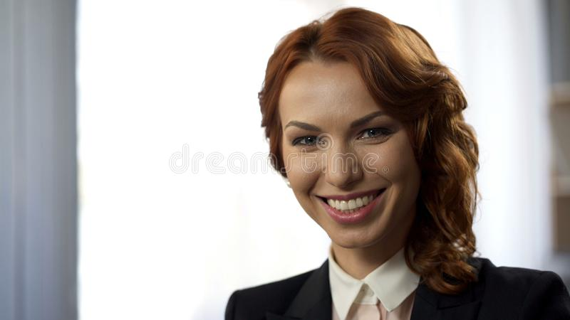 Smiling young woman looking into camera, close-up of successful business lady stock images