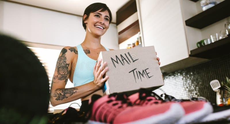 Female vlogger making mail time vlog stock image