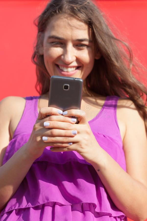 Young woman looking at smartphone stock photos
