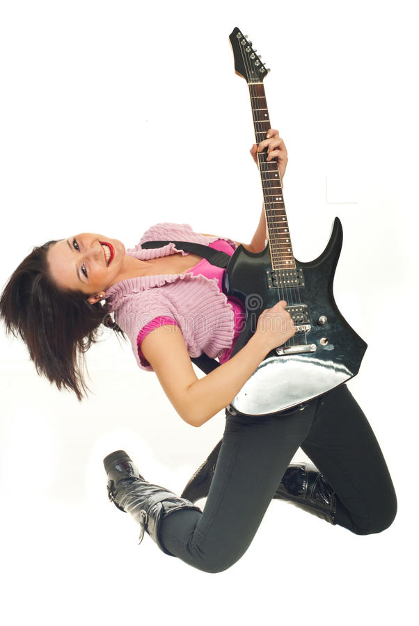 Smiling young woman playing rock guitar royalty free stock photo