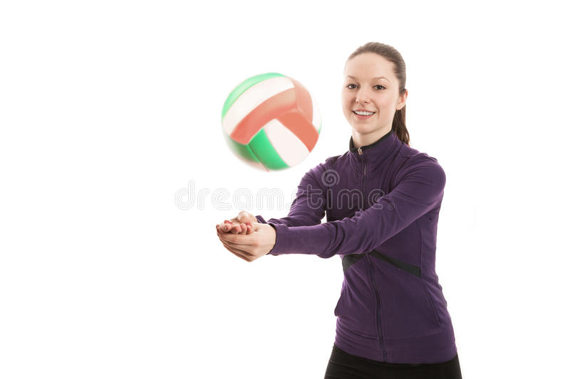 Smiling young woman playing volleyball. Isolated royalty free stock photo