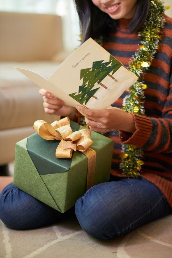 Reading Christmas greeting card stock photos