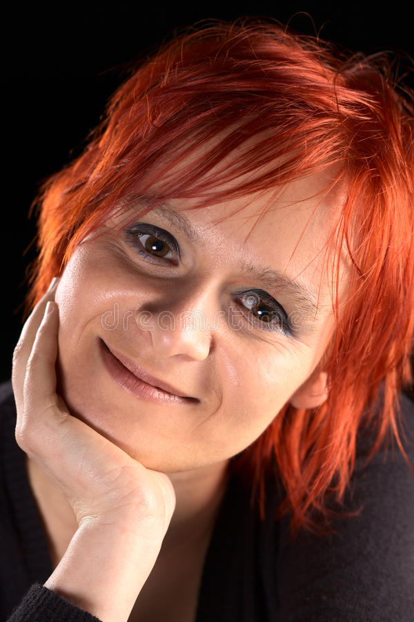 Smiling Young Woman with Red Hair royalty free stock images