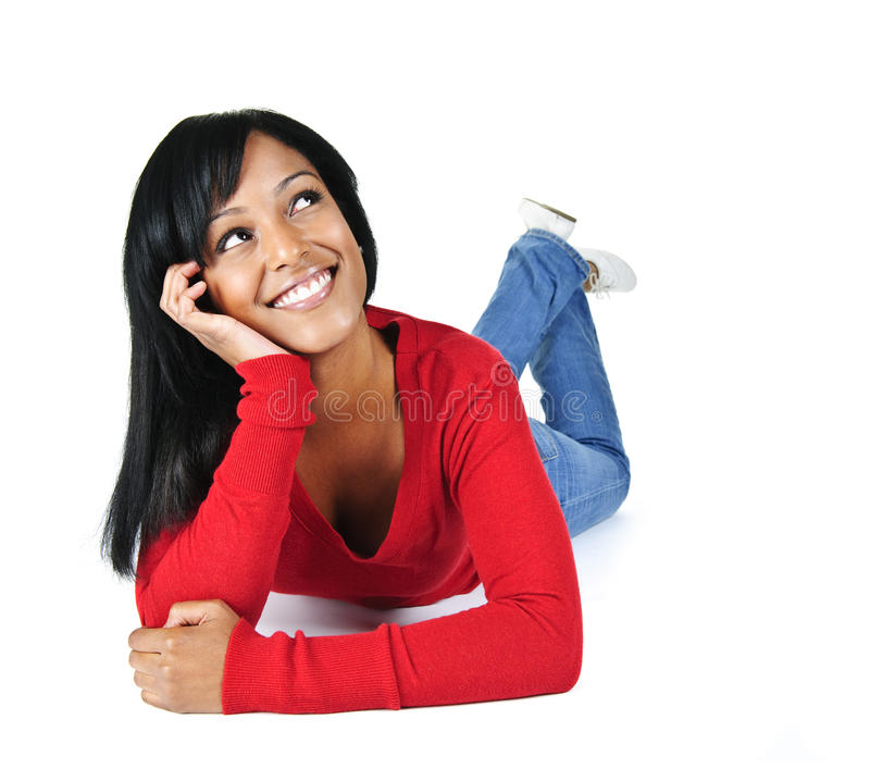 Smiling young woman relaxing looking up royalty free stock images