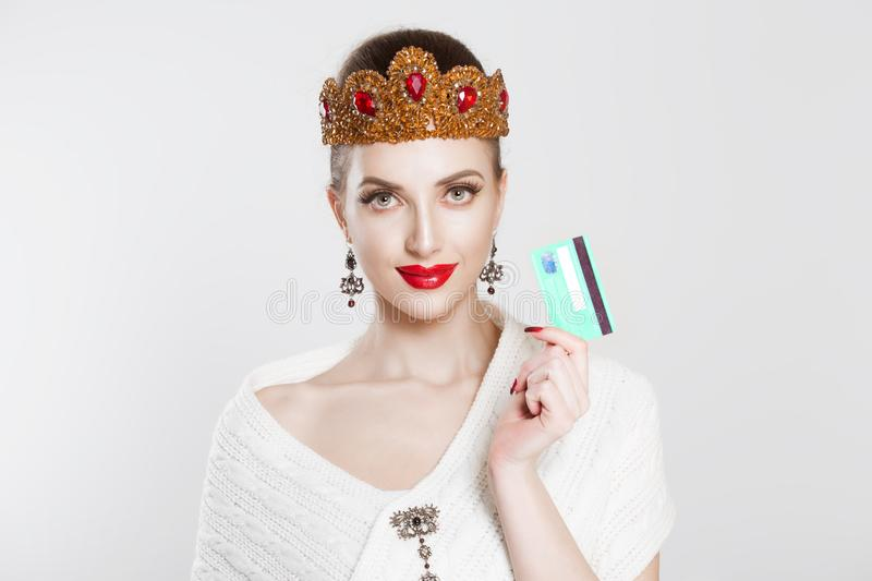 Smiling young woman retro style holding gold credit card. isolated portrait stock photos