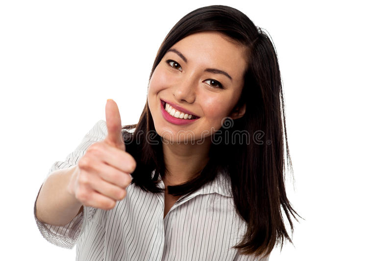 Smiling young woman showing thumbs up royalty free stock images