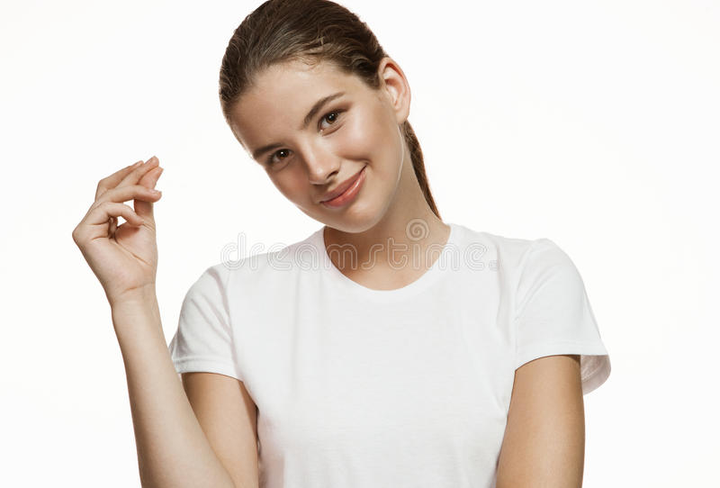 Smiling young woman snapping fingers stock photo