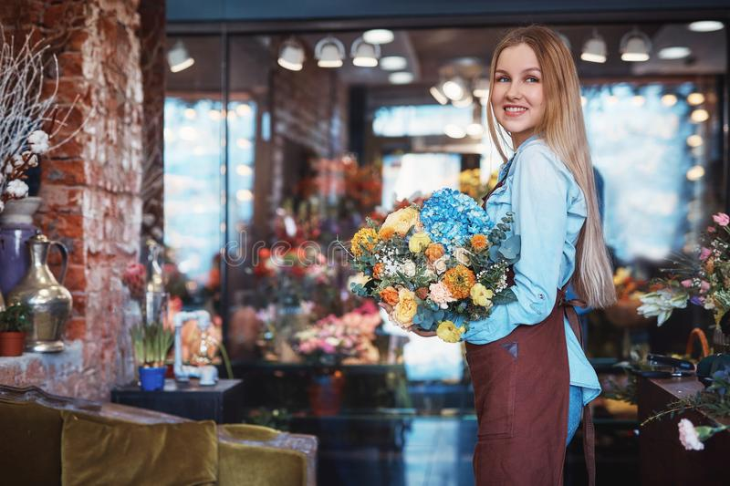 Smiling young woman in the store stock photography