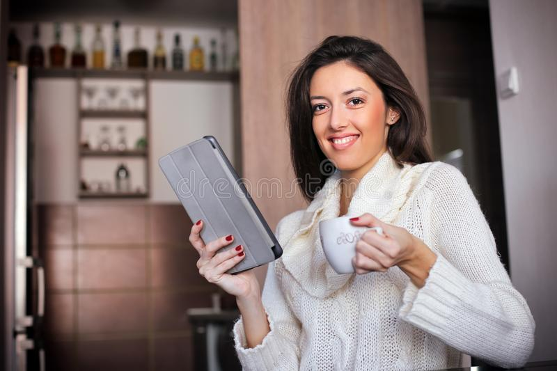 Morning coffee with tablet computer royalty free stock photo