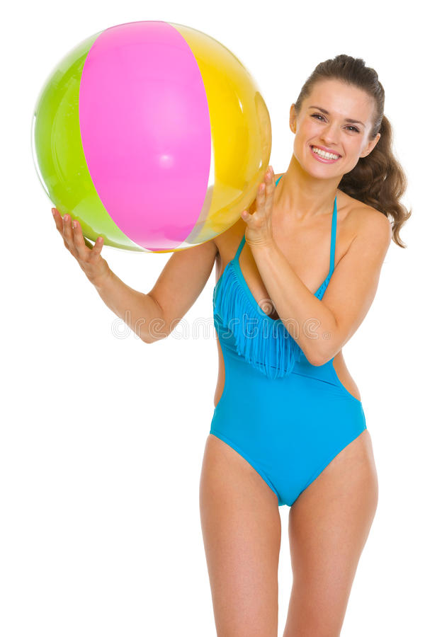 Smiling young woman in swimsuit with beach ball. Isolated on white royalty free stock photos