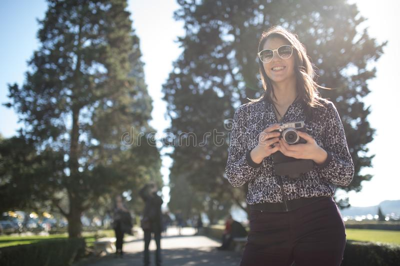 Smiling young woman talking on her smartphone on the street.Communicating with friends,free calls and messages for young people. stock photo