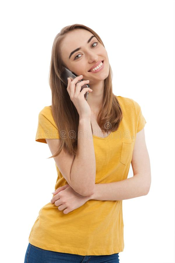 Free Smiling Young Woman Talking On Phone Isolated On White. Copy Space And Fashion. Mock Up. Yellow T-shirt. Stock Photography - 116812512