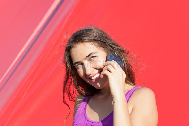 Young woman talking on smartphone stock images