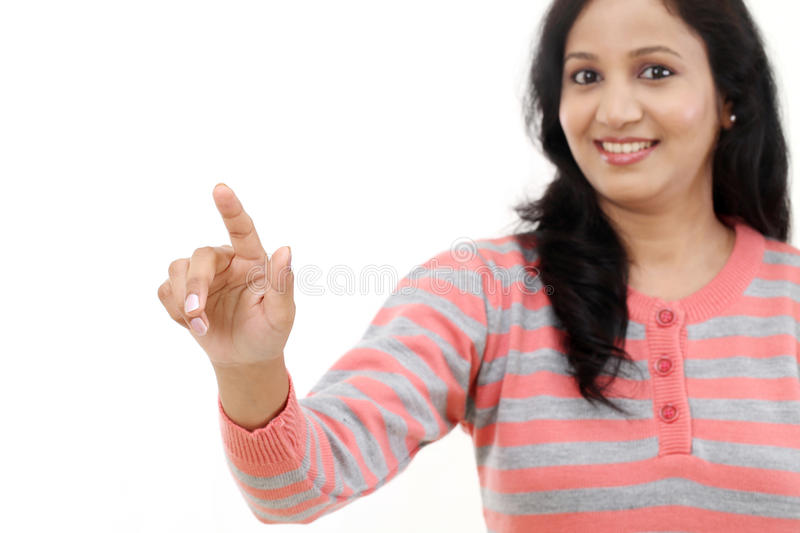 Smiling young woman touching imaginary screen. With her finger stock photos