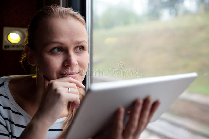 Smiling young woman traveling by train stock photos