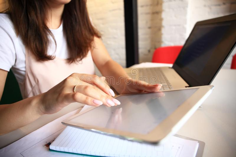 Smiling young woman using digital tablet in the office. stock image