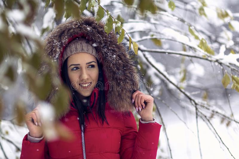 Smiling woman in wintertime . Girl enjoying in the snow royalty free stock photos