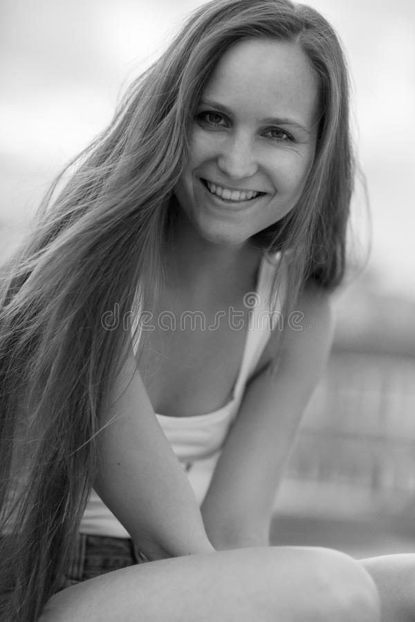 Smiling young women model outdoor. Pretty nordic scandinavian girl model posing outdoor in the city. Natural look photo royalty free stock images