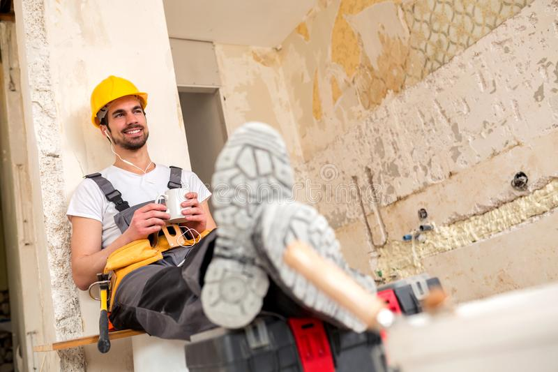 Smiling young worker enjoying his break time stock photos