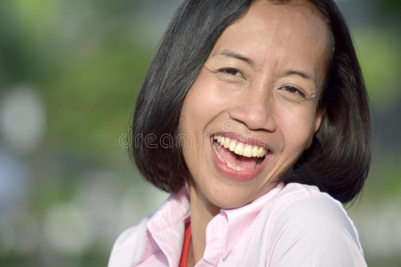 Smiling Youthful Filipina Female. An attractive and asian person stock photo
