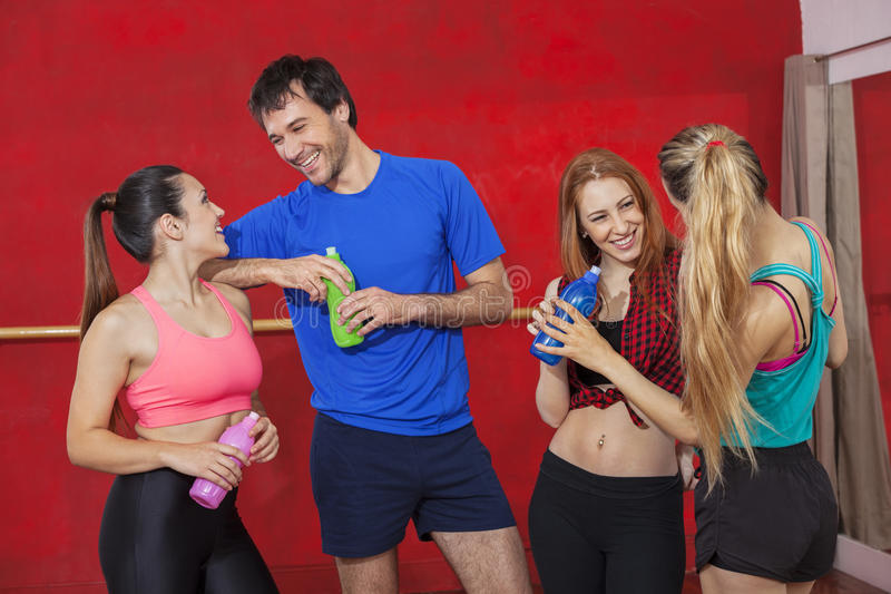 Smiling Zumba Dancers Holding Water Bottles In Gym royalty free stock photography