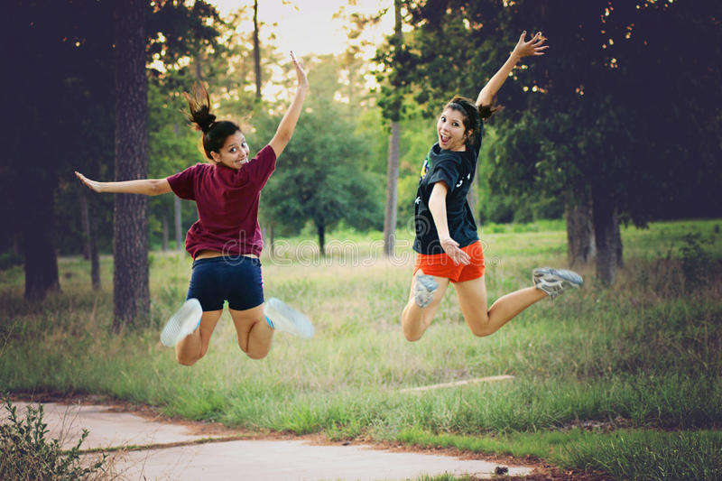Smilling when jumping in the forrest royalty free stock photos