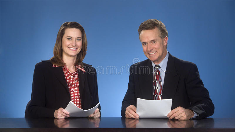 Smilng newcasters. royalty free stock images