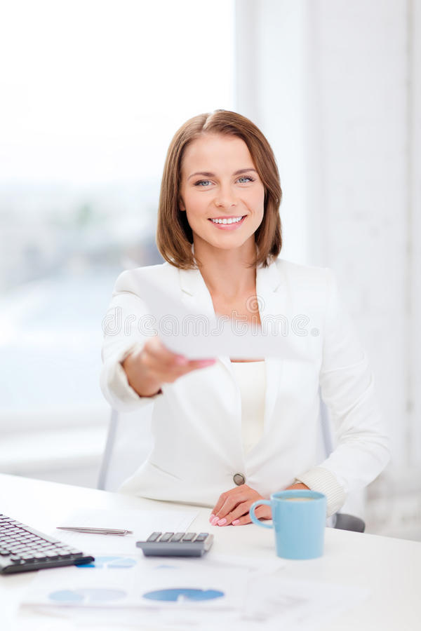 Download Sming Businesswoman Giving Papers In Office Stock Photo - Image: 40042168