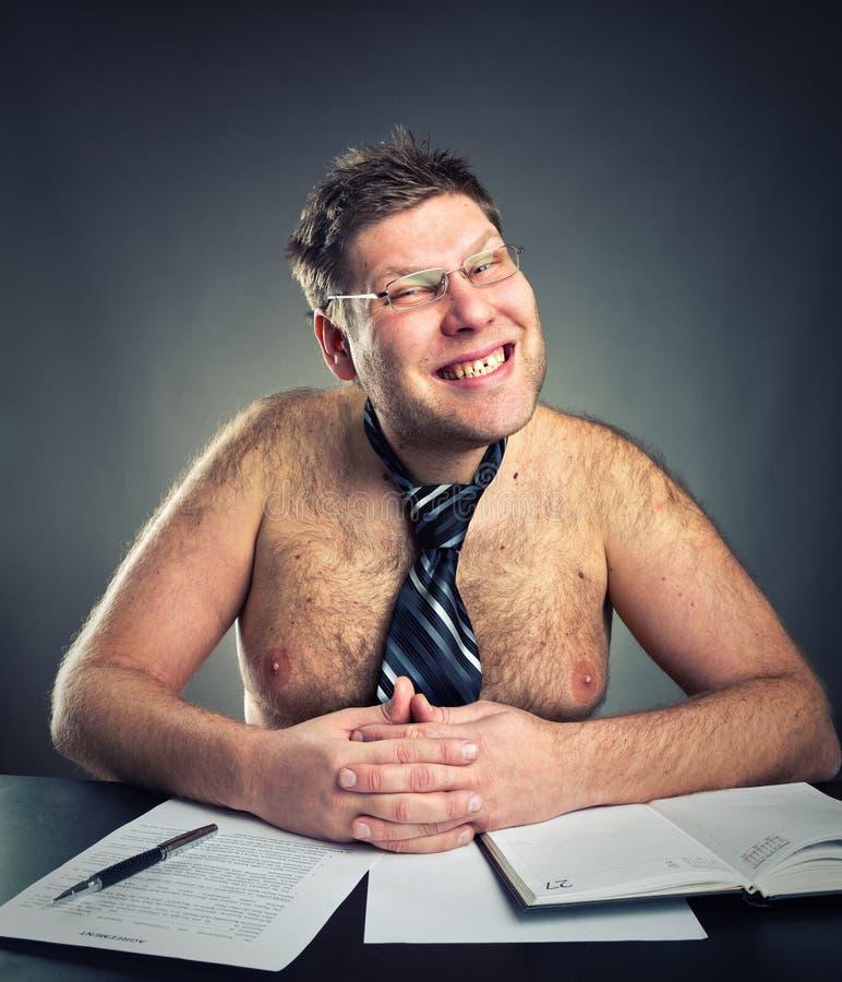 Smirking businessman. Smirking shirtless businessman studio image royalty free stock photo