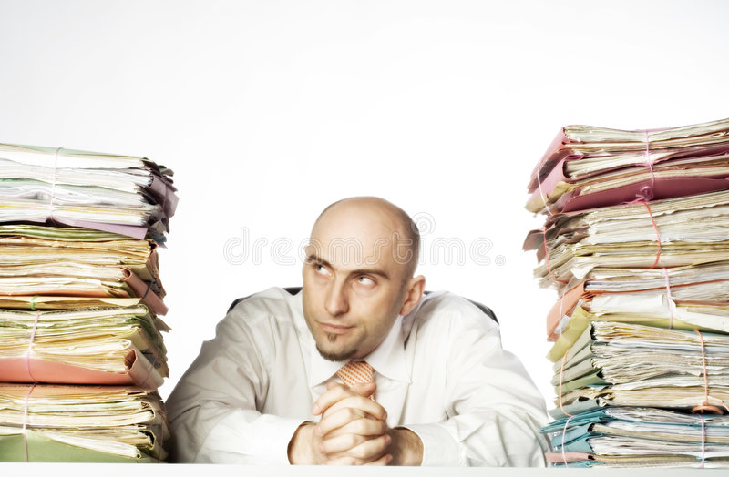 Smirking man with files royalty free stock photography
