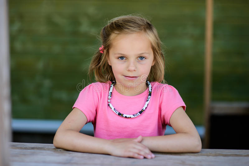 Smirky Smile. A little girl in a pink t-shirt royalty free stock photos